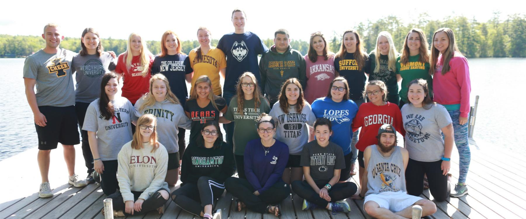 Students wearing sweatshirts from their colleges